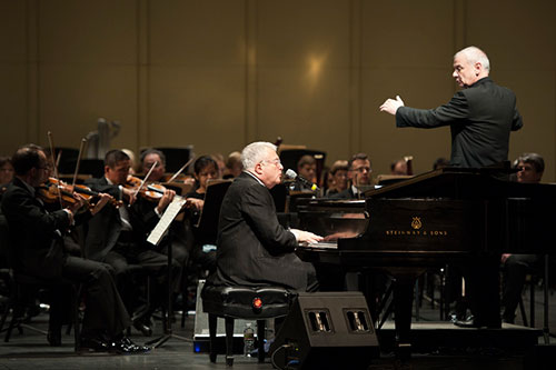 Conductor Bill Grimes leads the Louisiana Philharmonic and Randy